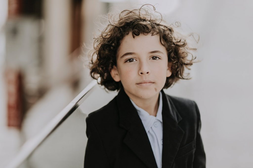 Young boy wearing a business suit